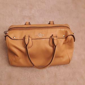 Coach satchel purse Orange Peel in color